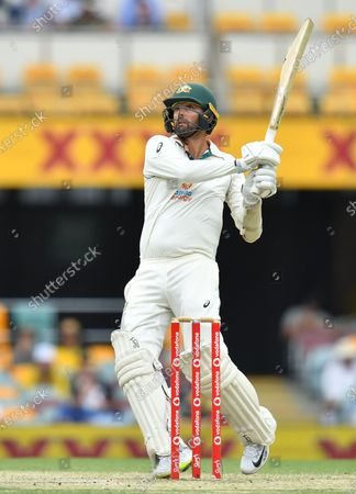 Nathan Lyon of Australia hits six runs during day four of the fourth Test Match between Australia and India at the Gabba in Brisbane, Australia, 18 January 2021.