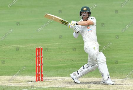 David Warner of Australia hits four runs during day four of the fourth Test Match between Australia and India at the Gabba in Brisbane, Australia, 18 January 2021.