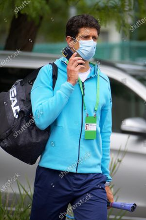 Brazilian Tennis player Marcelo Melo is escorted from his hotel room to practice in Melbourne, Australia, 18 January 2021. Players who were aboard two flights that had four positive COVID-19 cases are in hard quarantine, unable to join their colleague who can train for up to five hours a day.
