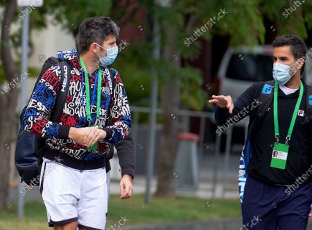Stock Photo of (L-R) Italian tennis player Simone Bolelli and Argentinian Tennis player Maximo Gonzalez are escorted to their training session in Melbourne, Australia, 18 January 2021. Players who were aboard two flights that had four positive COVID-19 cases are in hard quarantine, unable to join their colleague who can train for up to five hours a day.