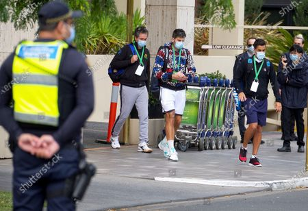 (C-L to C-R) Italian tennis player Simone Bolelli and Argentinian Tennis player Maximo Gonzalez are escorted to their training session in Melbourne, Australia, 18 January 2021. Players who were aboard two flights that had four positive COVID-19 cases are in hard quarantine, unable to join their colleague who can train for up to five hours a day.