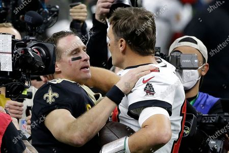 Stock Photo of New Orleans Saints quarterback Drew Brees, center left, speaks with Tampa Bay Buccaneers quarterback Tom Brady after an NFL divisional round playoff football game, in New Orleans. The Buccaneers won 30-20
