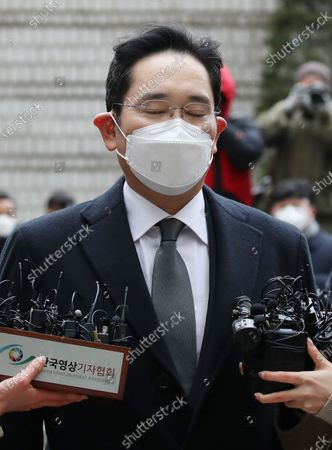 Samsung Electronics Co. Vice Chairman Lee Jae-yong closes his eyes after arriving at the Seoul High Court in Seoul, South Korea, 18 January 2021, to attend a sentencing hearing over a bribery scandal. Lee was sentenced to two years and six months in prison over bribes to former President Park Geun-hye and her longtime friend, Choi Soon-sil, and taken into custody immediately after the ruling. In August 2019, the Supreme Court ordered the appellate court to review its suspended jail sentence for Lee over the scandal.