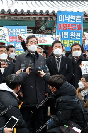 Lee Nak-yon (C), leader of the ruling Democratic Party, speaks to reporters at a national cemetery in the southwestern city of Gwangju, South Korea, 18 January 2021, after paying tribute to pro-democracy martyrs. The National Cemetery for the May 18th Democratic Uprising honors the hundreds of citizens killed in the region during protests against the military junta of Gen. Chun Doo-hwan in May 1980.