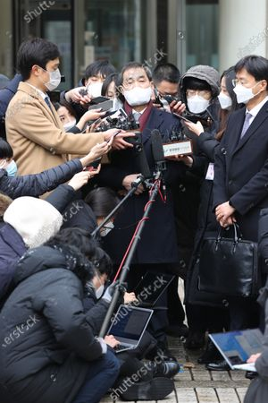 Lee In-jae (C), a lawyer for Samsung Electronics Co. Vice Chairman Lee Jae-yong, speaks to reporters at the Seoul High Court in Seoul, South Korea, 18 January 2021, after the Samsung Group heir was sentenced to two years and six months in prison over bribes to former President Park Geun-hye and her longtime friend, Choi Soon-sil, and taken into custody immediately after the ruling. In August 2019, the Supreme Court ordered the appellate court to review its suspended jail sentence for Lee over the scandal.