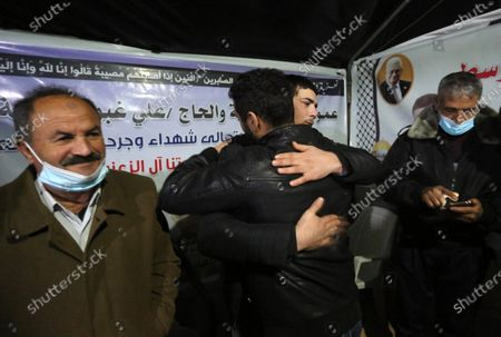 Freed Palestinian fisherman Yasser al-Zazoua, is welcomed by relatives upon his release from Egyptian authorities, at his home in Deir Al-Balah in the center of Gaza strip, on January 17, 2021. The Egyptian-Palestinian army arrested Yasser Al-Zaazou (18 years old), after he was shot on September 25 of last year, and his two brothers Hassan (26 years) and Mahmoud (20 years) were killed while they were working in the sea border area between Egypt and the Gaza Strip.