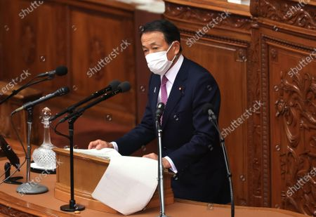 Japanese Finance Minister Taro Aso delivers a financial speech at Lower House's plenary session at the National Diet in Tokyo on Monday, January 18, 2021. Diet convenes 150-day regular session on January 18 amid outbreak of the new coronavirus.