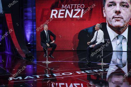 Stock Picture of Former Italian Prime Minister and Leader of Italian party Italia Viva, Matteo Renzi (L), journalist Massimo Giletti during the show 'Non e l'arena'