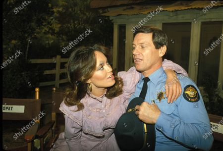 Stock Photo of Catherine Bach And Sonny Shroyer 1983