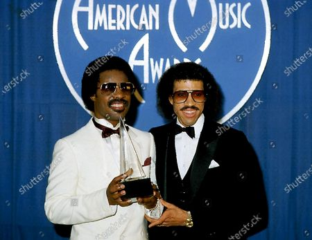 Stock Image of Stevie Wonder and Lionel Richie attend Ninth Annual American Music Awards on January 25, 1982 at the Shrine Auditorium in Los Angeles, California.