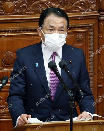 Wearing a face mask, Japan's Finance Minister Taro Aso delivers a speech at a House of Representatives plenary session of the parliament in Tokyo, Japan, 18 January 2021. Finance Minister Taro Aso said he will take measures to restore the economy hit by the Covid-19 coronavirus pandemic.