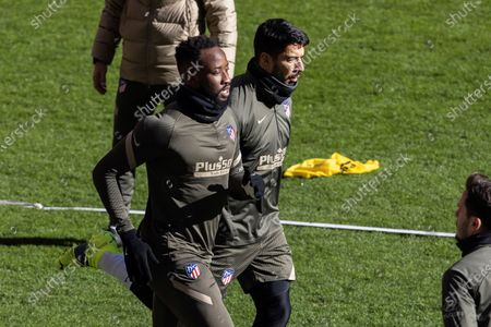 Atletico Madrid's French striker Ousmane Dembele (L) and Uruguayan striker Luis Suarez (R) in action during the training of the team held at Wanda Metropolitano stadium in Madrid, Spain, 18 January 2021. Atletico Madrid will face UD Eibar upcoming 21 January.