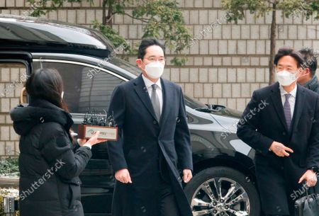 Lee Jae-Yong or Jay Y Lee (C, 52), vice chairman of Samsung Electronics, arrives at the Seoul High Court to attend a sentencing hearing.The Seoul High Court on Monday sentenced the Samsung heir to two and a half years in prison in a retrial of a bribery case involving former South Korean President Park Geun-Hye and ordered him to return to prison.