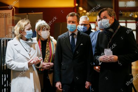 Stock Image of Grand Duke Henri of Luxembourg (C) with Luxembourg Minister of Health Paulette Lenert (L) during a visit to the vaccination center at Hall Victor Hugo, in Luxembourg, 18 January 2021. Luxembourg citizens as well as cross-border workers receive an appointment for vaccination against COVID-19 thanks to the code provided in the invitation received by post. In the vaccination strategy, the first people to be vaccinated were health professionals and hospital staff.