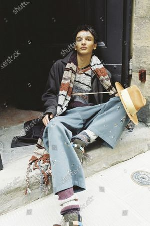 Stock Image of A Model wearing an outfit from the men s ready to wear collections, autumn-winter 2021 - 2022, original creation, during the Menswear Fashion Week in Milano, from the house of Nick Fouquet - Federico Curradi