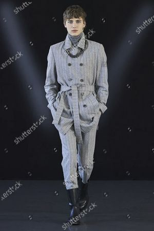 Stock Image of A Model wearing an outfit from the men s ready to wear collections, autumn-winter 2021 - 2022, original creation, during the Menswear Fashion Week in Milano, from the house of Miguel Vieira
