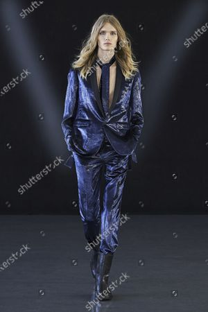 Stock Picture of A Model wearing an outfit from the men s ready to wear collections, autumn-winter 2021 - 2022, original creation, during the Menswear Fashion Week in Milano, from the house of Miguel Vieira