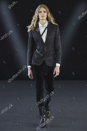 A Model wearing an outfit from the men s ready to wear collections, autumn-winter 2021 - 2022, original creation, during the Menswear Fashion Week in Milano, from the house of Miguel Vieira