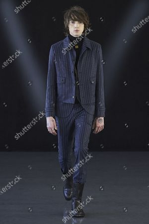 Stock Photo of A Model wearing an outfit from the men s ready to wear collections, autumn-winter 2021 - 2022, original creation, during the Menswear Fashion Week in Milano, from the house of Miguel Vieira