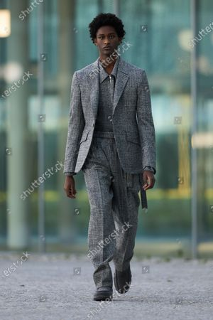 A Model wearing an outfit from the men s ready to wear collections, autumn-winter 2021 - 2022, original creation, during the Menswear Fashion Week in Milano, from the house of Ermenegildo Zegna