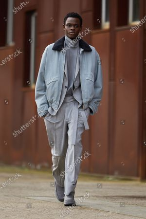 Stock Picture of A Model wearing an outfit from the men s ready to wear collections, autumn-winter 2021 - 2022, original creation, during the Menswear Fashion Week in Milano, from the house of Ermenegildo Zegna