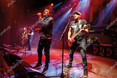 Stock Image of (L-R) Tommy Gentry, Andy Carr, Dante Gizzi and Jools Gizzi of Scottish hard rock group Gun performing live on stage at Shepherd's Bush Empire in London, on December 11, 2019. (Photo by Kevin Nixon/Classic Rock Magazine)