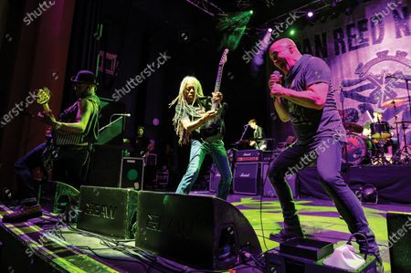 (L-R) Melvin Brannon II, Brion James and Dan Reed of American funk rock group Dan Reed Network performing live on stage at Shepherd's Bush Empire in London, on December 11, 2019. (Photo by Kevin Nixon/Classic Rock Magazine)