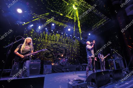 (L-R) Brion James, Dan Reed and Melvin Brannon II of American funk rock group Dan Reed Network performing live on stage at Shepherd's Bush Empire in London, on December 11, 2019. (Photo by Kevin Nixon/Classic Rock Magazine)