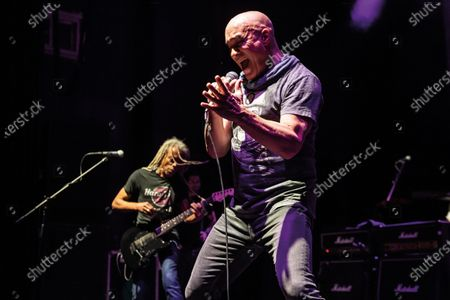 Guitarist Brion James (L) and vocalist Dan Reed of American funk rock group Dan Reed Network performing live on stage at Shepherd's Bush Empire in London, on December 11, 2019. (Photo by Kevin Nixon/Classic Rock Magazine)
