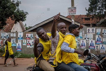 Supporters of Uganda's ruling National Resistance Movement party drive around Kampala on boda bodas (motorcycles) following the announcement that Yoweri Museveni has won the sixth term as president.