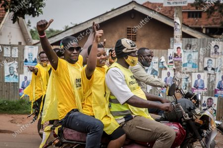 Stock Photo of Supporters of Uganda's ruling National Resistance Movement party drive around Kampala on boda bodas (motorcycles) following the announcement that Yoweri Museveni has won the sixth term as president.
