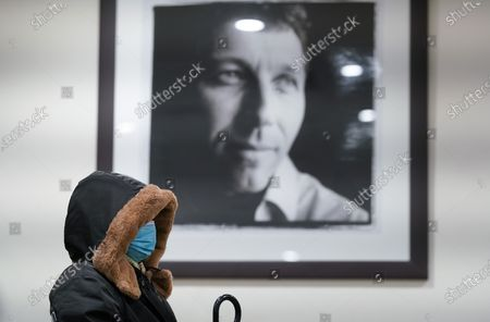 Stock Picture of At Lord's Cricket Ground, near a portrait of cricketer Mike Atherton, a local resident rests after having the Pfizer Covid 19 vaccination at The Thomas Lord Suite, upstairs from the Lords' Tavern pub