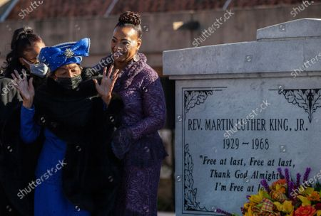 Stock Picture of Christine King Farris, sister of Martin Luther King, Jr., raises her hands while standing with Dr. Bernice King, daughter of Martin Luther King, Jr., right, after laying a wreath at the crypt, in honor of Martin Luther King Jr. Day, in Atlanta