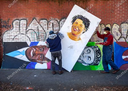 Artists set up a painting of Stacey Abrams in the King Historic District, in honor of Martin Luther King Jr. Day, in Atlanta