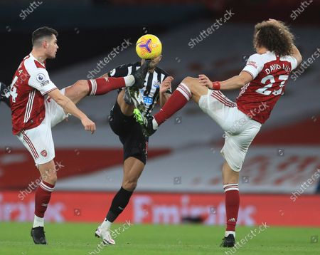 Stock Picture of Arsenal's Granit Xhaka, left, Arsenal's David Luiz, right, and Newcastle's Callum Wilson challenge for the ball during the English Premier League soccer match between Arsenal and Newcastle United at Emirates Stadium in London, England, Monday, Jan.18, 2021