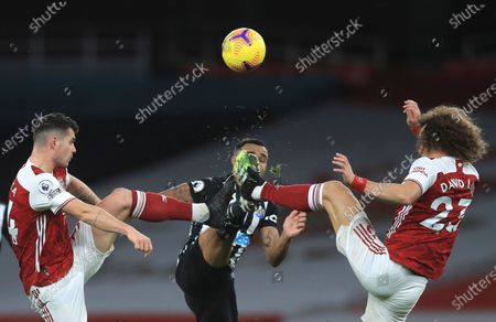 Stock Photo of Arsenal's Granit Xhaka, left, Arsenal's David Luiz, right, and Newcastle's Callum Wilson challenge for the ball during the English Premier League soccer match between Arsenal and Newcastle United at Emirates Stadium in London, England, Monday, Jan.18, 2021