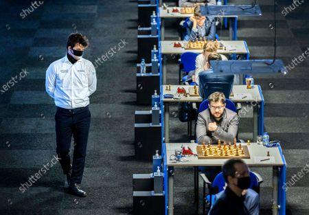 Chess grandmaster Magnus Carlsen walks around during the first round of the international chess tournament TataSteel Chess Tournament 2021.