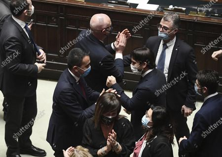 Luigi Di Maio celebrates with Alfonso Bonafede and Roberto Speranza after the confidence vote for Italian Premier Giuseppe Conte at the lower chamber of Parliament, in Rome, . Conte fights for his political life and shoring up support for his government, which has come under fire over plans to relaunch the pandemic-ravaged economy