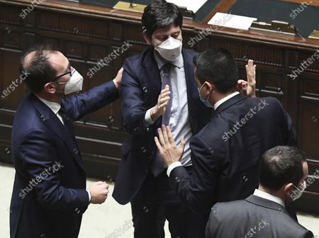 Luigi Di Maio, right, celebrates with Alfonso Bonafede and Roberto Speranza after the confidence vote for Italian Premier Giuseppe Conte at the lower chamber of Parliament, in Rome, . Conte fights for his political life and shoring up support for his government, which has come under fire over plans to relaunch the pandemic-ravaged economy