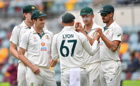 Pat Cummins, Nathan Lyon, Josh Hazlewood and Mitchell Starc of Australia are seen during day five of the fourth Test Match between Australia and India at the Gabba in Brisbane, Australia, 19 January 2021.