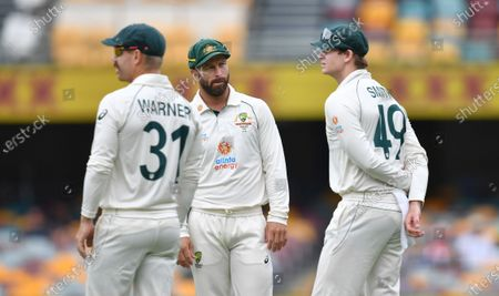 David Warner (left), Matthew Wade (centre) and Steve Smith (right) of Australia are seen during day five of the fourth Test Match between Australia and India at the Gabba in Brisbane, Australia, 19 January 2021.