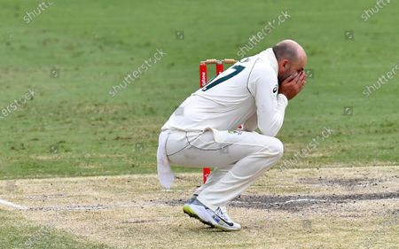 Nathan Lyon of Australia is seen reacting during day five of the fourth Test Match between Australia and India at the Gabba in Brisbane, Australia, 19 January 2021.
