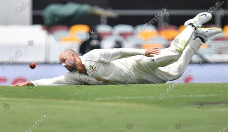 Nathan Lyon of Australia fields off his own bowling during day five of the fourth Test Match between Australia and India at the Gabba in Brisbane, Australia, 19 January 2021.