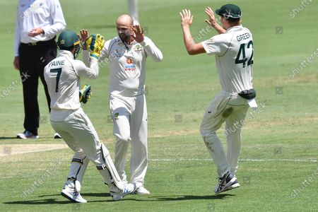 Nathan Lyon of Australia celebrates with team mates after getting the wicket of Shubman Gill of India during day five of the fourth Test Match between Australia and India at the Gabba in Brisbane, Australia, 19 January 2021.