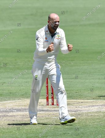 Nathan Lyon of Australia celebrates getting the wicket of Shubman Gill of India during day five of the fourth Test Match between Australia and India at the Gabba in Brisbane, Australia, 19 January 2021.