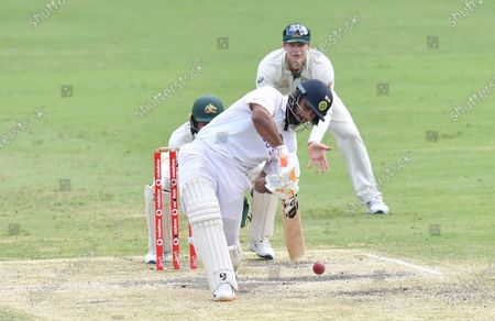 Rishabh Pant of India hits a six off the bowling of Nathan Lyon of Australia during day five of the fourth Test Match between Australia and India at the Gabba in Brisbane, Australia, 19 January 2021.