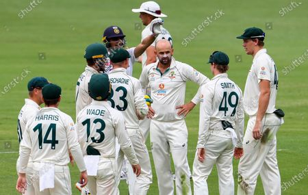 Australia's Nathan Lyon, centre, reacts as his video review is rejected during play on the final day of the fourth cricket test between India and Australia at the Gabba, Brisbane, Australia