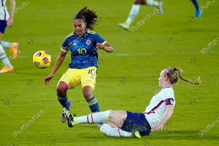 United States defender Becky Sauerbrunn, right, clears the ball away from Colombia forward Gisela Robledo (10) during the first half of an international friendly soccer match, in Orlando, Fla