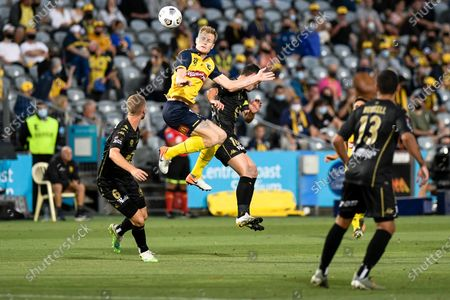 Matthew Simon of Central Coast Mariners wins a header against Graham Dorrans of Western Sydney Wanderers; Central Coast Stadium, Gosford, New South Wales, Australia; A League Football, Central Coast Mariners versus Western Sydney Wanderers.