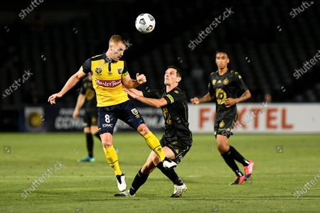 Oliver Bozanic of Central Coast Mariners heads clear as Graham Dorrans of Western Sydney Wanderers challenges; Central Coast Stadium, Gosford, New South Wales, Australia; A League Football, Central Coast Mariners versus Western Sydney Wanderers.